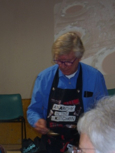 Robin Ellis cooking demonstration at the Parisot Literary Festival in Sex Pistols apron